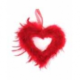 large feather hanging heart red